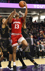 Indiana forward Juwan Morgan (13) goes to the basket as Northwestern forward A.J. Turner, left, defends him during the first half of an NCAA college basketball game Tuesday, Jan. 22, 2019, in Evanston, Ill. (AP Photo/David Banks)