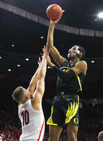 Oregon forward Kenny Wooten shoots over Arizona forward Ryan Luther (10) in the first half of an NCAA college basketball game, Thursday, Jan. 17, 2019, in Tucson, Ariz. (AP Photo/Rick Scuteri)