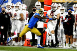 Stanford wide receiver Simi Fehoko (13) catches a pass while defended by UCLA defensive back Jay Shaw (1) during the first half of an NCAA college football game Saturday, Dec. 19, 2020, in Pasadena, Calif. (AP Photo/Ringo H.W. Chiu)