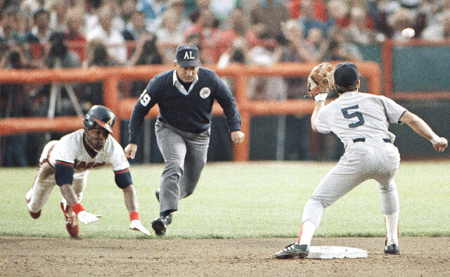 FILE - In this Oct. 11, 1986, file photo, California Angels' Gary Pettis, left, is caught stealing second base by Boston Red Sox shortstop Spike Owen (5) as umpire Richie Garcia, center, looks on during the third inning of a baseball game in Anaheim, Calif. Ten years after Garcia was fired by Major League Baseball, he wants to set the record straight: He did not get fired for trying to evaluate his son-in-law, then a minor league umpire. Garcia thinks baseball's top executives just wanted him out. (AP Photo/Jeff Robbins, File)