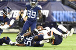 Chicago Bears wide receiver Dazz Newsome, right, loses his helmet as he is brought down by Tennessee Titans linebacker Monty Rice (56) in the second half of a preseason NFL football game Saturday, Aug. 28, 2021, in Nashville, Tenn. (AP Photo/Mark Zaleski)