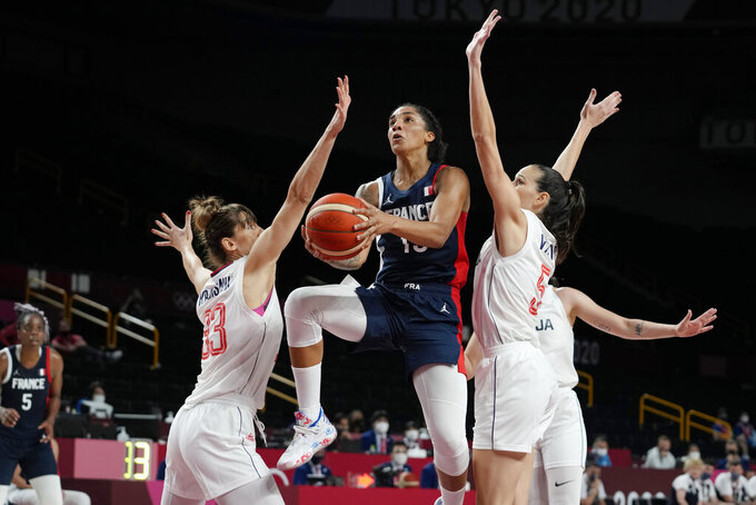 France's Gabrielle Williams (15) drives to the basket between Serbia's Tina Krajisnik (33) and Sonja Vasic (5) during a women's basketball bronze medal game at the 2020 Summer Olympics, Saturday, Aug. 7, 2021, in Saitama, Japan. (AP Photo/Eric Gay)