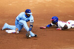 Philadelphia Phillies' Andrew McCutchen, right, steals second past Toronto Blue Jays second baseman Jonathan Villar during the third inning of the first baseball game in a doubleheader, Friday, Sept. 18, 2020, in Philadelphia. (AP Photo/Matt Slocum)