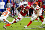 Arizona Cardinals running back Kenyan Drake (41) tries to elude Cleveland Browns free safety Damarious Randall (23) and middle linebacker Joe Schobert (53) during the second half of an NFL football game, Sunday, Dec. 15, 2019, in Glendale, Ariz. (AP Photo/Rick Scuteri)