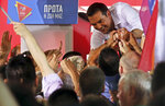 Greek Prime Minister and Syriza party leader Alexis Tsipras greets supporters during his main election campaign rally in Athens, Friday, July 5, 2019. Greeks head to the polls in early general elections on Sunday, July 7. (AP Photo/Petros Giannakouris)