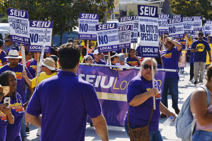 FILE - In this Sept. 4, 2017, file photo, Service Employees International Union members gather for a Labor Day rally in downtown Los Angeles. The president of California's largest state employees union has been ousted from the post she held for 13 years and replaced by a candidate who promises to end the organization's political involvement while bolstering its membership, according to results from a low-turnout election posted by the union. (AP Photo/Richard Vogel, File)