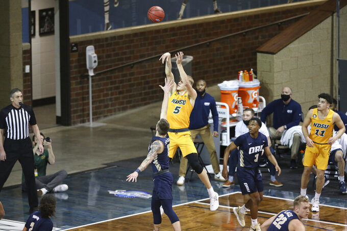 North Dakota State guard Sam Griesel (5) shoots against Oral Roberts during the first half of an NCAA college basketball game for the Summit League men's tournament championship Tuesday, March 9, 2021, in Sioux Falls, S.D. (AP Photo/Josh Jurgens)