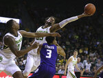 Baylor forward Freddie Gillespie (33) reaches for the ball with Kansas State guard Kamau Stokes (3) in the second half of an NCAA college basketball game, Saturday, Feb. 9, 2019, in Waco, Texas. (Rod Aydelotte/Waco Tribune Herald, via AP)
