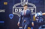Duke quarterback Daniel Jones walks the red carpet ahead of the first round at the NFL football draft, Thursday, April 25, 2019, in Nashville, Tenn. (AP Photo/Steve Helber)