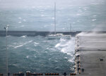 High waves pound a fishing port in Amami city, Kagoshima prefecture, southwestern Japan as a typhoon hits the region, Sunday, Sept. 6, 2020. The second powerful typhoon to slam Japan in a week unleashed fierce winds and rain on southern islands on Sunday, blowing off rooftops and leaving homes without power as it edged northward into an area vulnerable to flooding and mudslides. (Kyodo News via AP)
