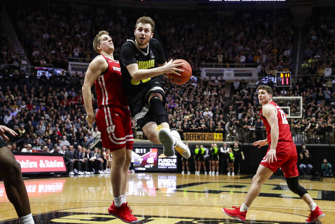 Purdue guard Sasha Stefanovic (55) drives past Wisconsin guard Brevin Pritzl (1) on his way to the basket during the second half of an NCAA college basketball game in West Lafayette, Ind., Friday, Jan. 24, 2020. (AP Photo/Michael Conroy)