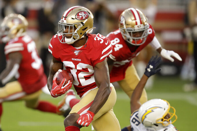 San Francisco 49ers' D.J. Reed (32) returns a kickoff against the Los Angeles Chargers during the first half of an NFL preseason football game in Santa Clara, Calif., Thursday, Aug. 29, 2019. (AP Photo/Ben Margot)