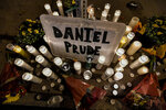 FILE - In this Sept. 2, 2020, file photo, candles light a makeshift memorial for Daniel Prude, a Black man who died while restrained and in police custody in Rochester, N.Y., in March. Prude died of asphyxiation after a group of police officers put a
