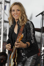 "Sheryl Crow performs on NBC's ""Today"" show at the Indianapolis Motor Speedway, Thursday, May 23, 2019, in Indianapolis. (AP Photo/Darron Cummings)"