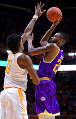 Tennessee Tech forward Malik Martin (25) attempts a shot against Tennessee forward Kyle Alexander (11) in the first half of an NCAA college basketball game Saturday, Dec. 29, 2018, in Knoxville, Tenn. (AP Photo/Shawn Millsaps)