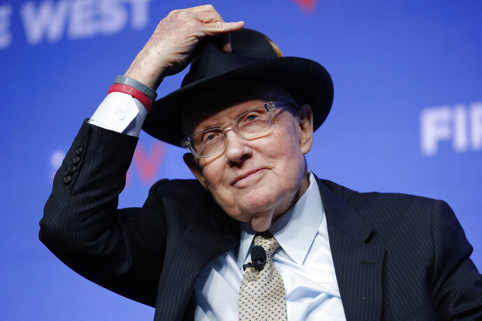 Former U.S. Sen. Harry Reid tips his hat during a fundraiser for the Nevada Democratic Party, Sunday, Nov. 17, 2019, in Las Vegas. (AP Photo/John Locher)