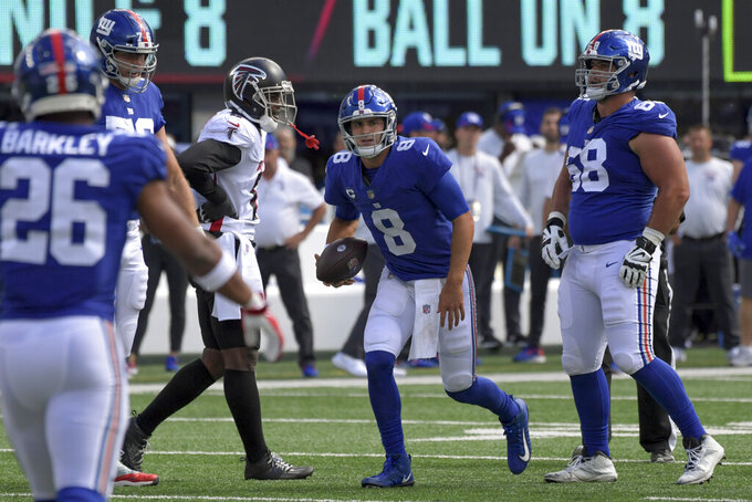 New York Giants quarterback Daniel Jones (8) stands up after a sack by Atlanta Falcons defensive tackle Grady Jarrett during the first half of an NFL football game, Sunday, Sept. 26, 2021, in East Rutherford, N.J. (AP Photo/Bill Kostroun)