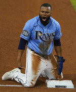 Tampa Bay Rays' Manuel Margot celebrates at third after a Los Angeles Dodgers fielding error during the fourth inning in Game 5 of the baseball World Series Sunday, Oct. 25, 2020, in Arlington, Texas. (AP Photo/Tony Gutierrez)