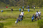FILE - In this April 21, 2020, file photo, golfers crowd the fairways at Rustic Canyon Golf Course in Moorpark, Calif. In the sporting goods industry, the impact of the coronavirus pandemic has depended on the focus of the business. (AP Photo/Mark J. Terrill, File)
