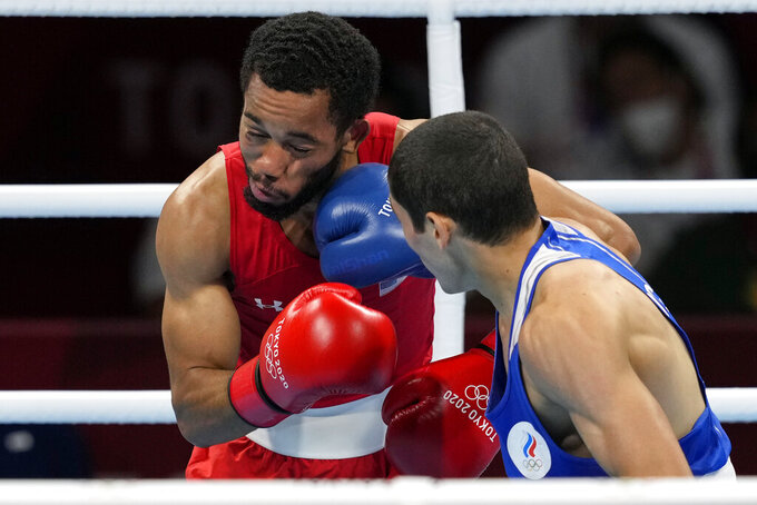 Albert Batyrgaziev, of the Russian Olympic Committee, right, connects with a punch to Duke Ragan, of the United States, during their final round feather weight 52-57kg final boxing match at the 2020 Summer Olympics, Thursday, Aug. 5, 2021, in Tokyo, Japan. (AP Photo/Themba Hadebe)