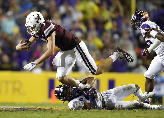 Mississippi State quarterback Nick Fitzgerald (7) is stopped by Mississippi State defensive end Montez Sweat (9) during an NCAA college football game in Baton Rouge, La., Saturday, Oct. 20, 2018. LSU won 19-3. (AP Photo/Tyler Kaufman)