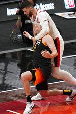 Portland Trail Blazers center Jusuf Nurkic, top, fouls Utah Jazz guard Joe Ingles during the second half of an NBA basketball game Wednesday, May 12, 2021, in Salt Lake City. (AP Photo/Rick Bowmer)