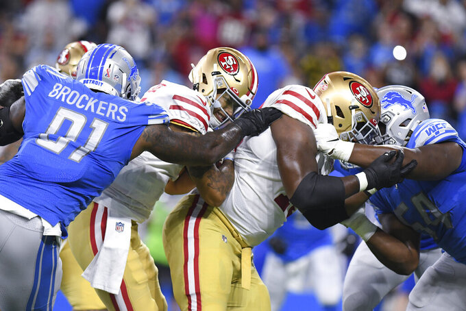 San Francisco 49ers quarterback Trey Lance (5) runs the ball as Detroit Lions defensive end Michael Brockers (91) defends n the first half of an NFL football game in Detroit, Sunday, Sept. 12, 2021. (AP Photo/Lon Horwedel)