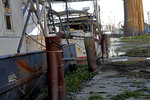 Fishing vessels are seen docked in Morgan City, La. Monday, May 11, 2020. Attempts to curb the spread of COVID-19 have visited a kind of triple economic whammy on the state. As oil prices have plummeted, the industry laid off workers.   (AP Photo/Gerald Herbert)