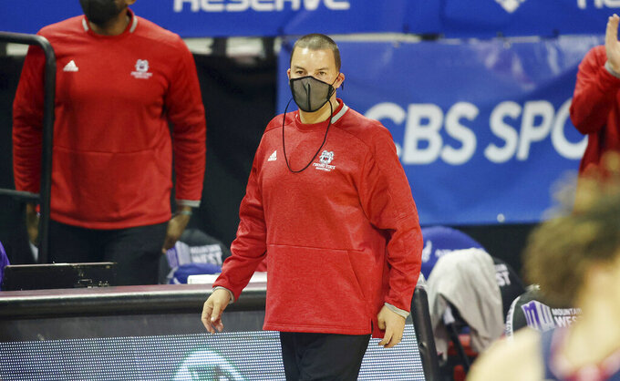 Fresno State coach Justin Hutson watches his team play during the second half of an NCAA college basketball game against Colorado State in the quarterfinals of the Mountain West Conference men's tournament Thursday, March 11, 2021, in Las Vegas. (AP Photo/Isaac Brekken)