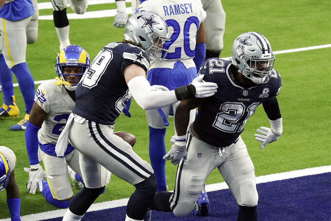 Dallas Cowboys running back Ezekiel Elliott (21) celebrates after scoring a touchdown against the Los Angeles Rams during the first half of an NFL football game Sunday, Sept. 13, 2020, in Inglewood, Calif. (AP Photo/Jae C. Hong )