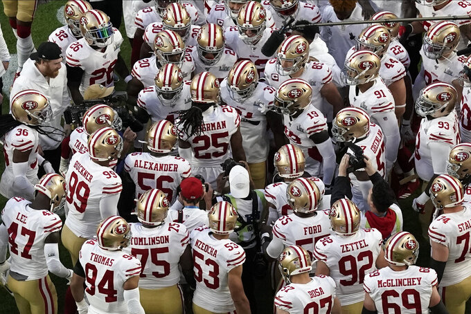 The San Francisco 49ers surround Richard Sherman (25) on the field, before the NFL Super Bowl 54 football game between the San Francisco 49ers and Kansas City Chiefs, Sunday, Feb. 2, 2020, in Miami Gardens, Fla. (AP Photo/Morry Gash)