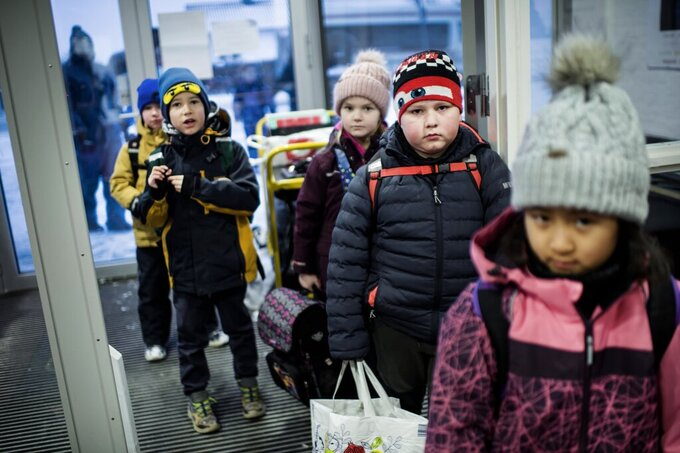 Third grade students arrive at Tved School, in Svendborg, on the island of Funen, Denmark, Monday, Feb. 8, 2021. Students in the lower grades returned to the classrooms after schools were closed in an effort to control the spread of coronavirus. Denmark's Prime Minister Mette Frederiksen said Monday it was uncertain when older students would return to school. (Tim Kildeborg Jensen/Ritzau Scanpix via AP)
