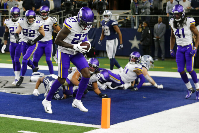 Minnesota Vikings safety Jayron Kearse (27) celebrates after intercepting in the end zone a pass by Dallas Cowboys quarterback Dak Prescott on the final play of an NFL football game in Arlington, Texas, Sunday, Nov. 10, 2019. The Vikings won 28-24.(AP Photo/Michael Ainsworth)