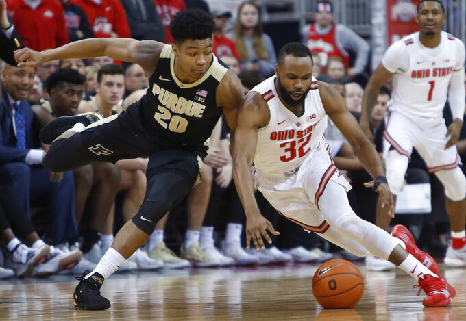 Purdue's Nojel Eastern, left, and Ohio State's Keyshawn Woods chase the ball during the first half of an NCAA college basketball game Wednesday, Jan. 23, 2019, in Columbus, Ohio. (AP Photo/Jay LaPrete)