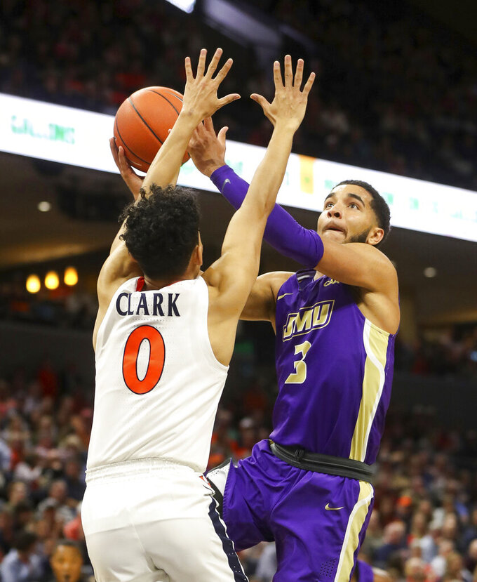 James Madison guard Deshon Parker (3) is defended by Virginia guard Kihei Clark (0) during an NCAA college basketball game in Charlottesville, Va., Sunday, Nov. 10, 2019. (AP Photo/Andrew Shurtleff)