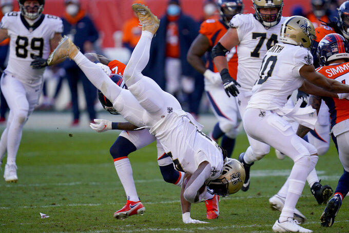 New Orleans Saints running back Alvin Kamara is up-ended against the Denver Broncos during the first half of an NFL football game, Sunday, Nov. 29, 2020, in Denver. (AP Photo/David Zalubowski)
