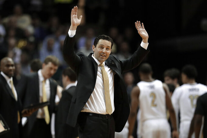 FILE - In this Jan. 23, 2019, file photo, Vanderbilt head coach Bryce Drew reacts to an official's call in the second half of an NCAA college basketball game against Tennessee in Nashville, Tenn. Vanderbilt's worst start ever in the Southeastern Conference could get much uglier. The Commodores host Kentucky on Tuesday, Jan. 29, 2019, having lost six straight league games and seven overall after a blowout loss to Oklahoma in the Big 12/SEC Challenge. (AP Photo/Mark Humphrey, File)