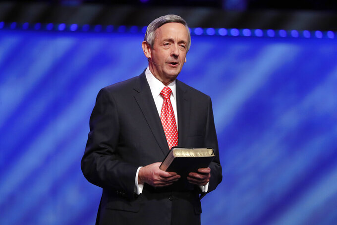 FILE - In this Sunday, June 28, 2020 file photo, Senior Pastor Dr. Robert Jeffress addresses attendees at First Baptist Church Dallas during a Celebrate Freedom Rally in Dallas. Jeffress believes a majority of his congregation welcome the COVID-19 vaccines, while some have doubts about their safety or worry they have links to abortion. Jeffress is among numerous religious leaders who say the leading vaccines are acceptable given their remote, indirect links to lines of cells developed from aborted fetuses. (AP Photo/Tony Gutierrez)