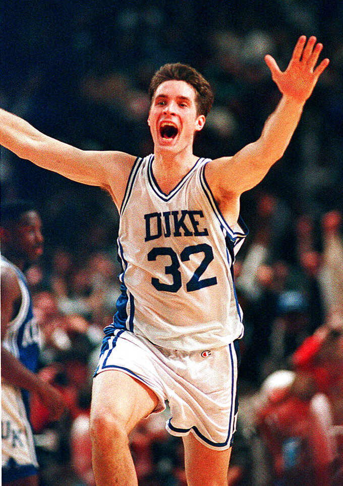 FILE - In this March 28, 1992, file photo, Duke's Christian Laettner runs down the court after making the last-second winning shot to defeat Kentucky in the East Regional final NCAA college basketball game in Philadelphia. The All-American ended one of the greatest college basketball games ever with a turnaround jumper at the overtime buzzer, giving defending national champion Duke a 104-103 victory over Kentucky and a fifth straight trip to the Final Four. (AP Photo/Amy Sancetta, File)
