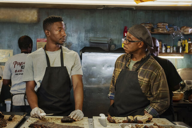This image released by Netflix shows Mamoudou Athie, left, and Courtney B. Vance in a scene from