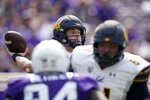 California quarterback Chase Garbers (7) throws a pass under pressure in the first half of an NCAA college football game against TCU in Fort Worth, Texas, Saturday, Sept. 11, 2021. (AP Photo/Tony Gutierrez)