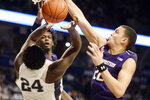 Penn State's Mike Watkins (24) has his shot knocked away by Northwestern's Jared Jones, center, and Pete Nance, right, during the first half of an NCAA college basketball game, Saturday, Feb. 15, 2020, in State College, Pa. (AP Photo/Gary M. Baranec)