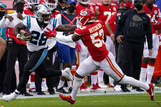 Carolina Panthers running back Mike Davis (28) runs against Kansas City Chiefs inside linebacker Anthony Hitchens (53) during the first half of an NFL football game in Kansas City, Mo., Sunday, Nov. 8, 2020. (AP Photo/Jeff Roberson)