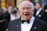 FILE - In this March 7, 2010, file photo, actor Ed Asner arrives during the 82nd Academy Awards in the Hollywood section of Los Angeles. Asner, the blustery but lovable Lou Grant in two successful television series, has died. He was 91. Asner's representative confirmed the death in an email Sunday, Aug. 29, 2021, to The Associated Press. (AP Photo/Chris Pizzello, File)