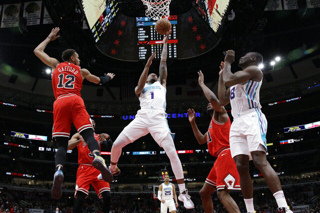 Charlotte Hornets guard Malik Monk (1) drives to the basket against the Chicago Bulls during the first half of an NBA basketball game in Chicago, Thursday, Feb. 20, 2020. (AP Photo/Nam Y. Huh)