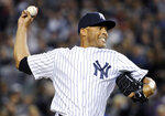 File- This Sept 26, 2013, file photo shows New York Yankees pitcher Mariano Rivera, delivers the ball to the Tampa Bay Rays during the eighth inning of a baseball game in New York. Rivera has become baseball's first unanimous Hall of Fame selection, elected along with Roy Halladay, Edgar Martinez and Mike Mussina. Rivera received all 425 votes in balloting by the Baseball Writers' Association of America. The quartet will be enshrined in Cooperstown along with Today's Game Era Committee selections Harold Baines and Lee Smith on July 21. (AP Photo/Bill Kostroun, File)