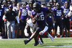 Northwestern running back Jesse Brown (36) is chased by UNLV defensive back Tykenzie Daniels (6) during the first half of an NCAA college football game, Saturday, Sept. 14, 2019, in Evanston, Ill. (AP Photo/Matt Marton)