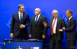 From left, Serbia's President Aleksander Vusic, Bulgarian Prime Minister Boyko Borissov, European Commission President Jean-Claude Juncker and European Council President Donald Tusk take their places prior to a signature ceremony on the sidelines of an EU and Western Balkan heads of state summit at the National Palace of Culture in Sofia, Bulgaria, Thursday, May 17, 2018. (AP Photo/Virginia Mayo)