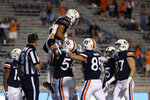 Virginia players celebrate a score during an NCAA college football game against Duke Saturday, Sept. 26, 2020, in Charlottesville, Va. (Erin Edgerton/The Daily Progress via AP)