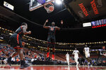 FILE - In this March 14, 2019, file photo, Cal State Northridge forward Lamine Diane celebrates a basket by guard Terrell Gomez, left, against UC Santa Barbara during the second half of an NCAA college basketball game at the Big West men's tournament in Anaheim, Calif. As a redshirt freshman last year, Diane earned honorable mention on the Associated Press All-America team and made 340 baskets to lead all Division I players. (AP Photo/Chris Carlson, File)